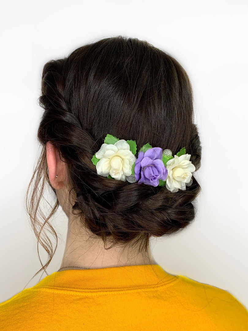 Bridal updo with flowers and twists