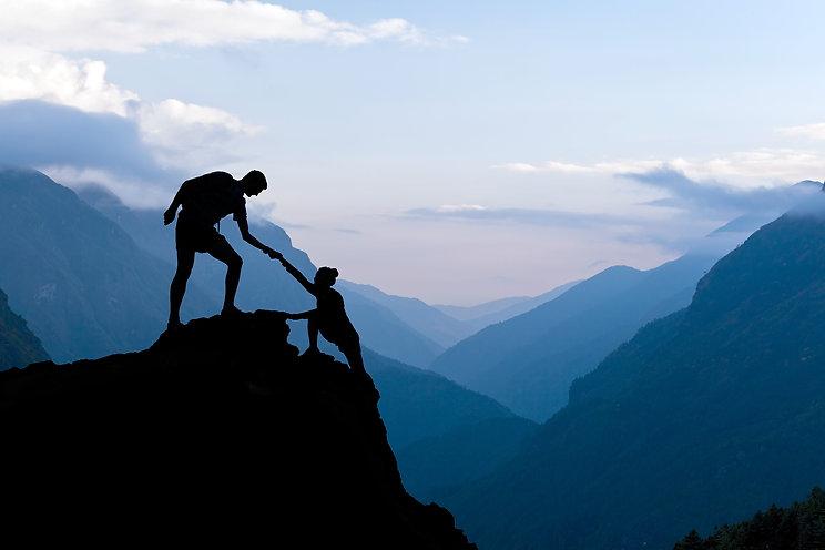 Teamwork Couple Climbing Helping Hand.jp