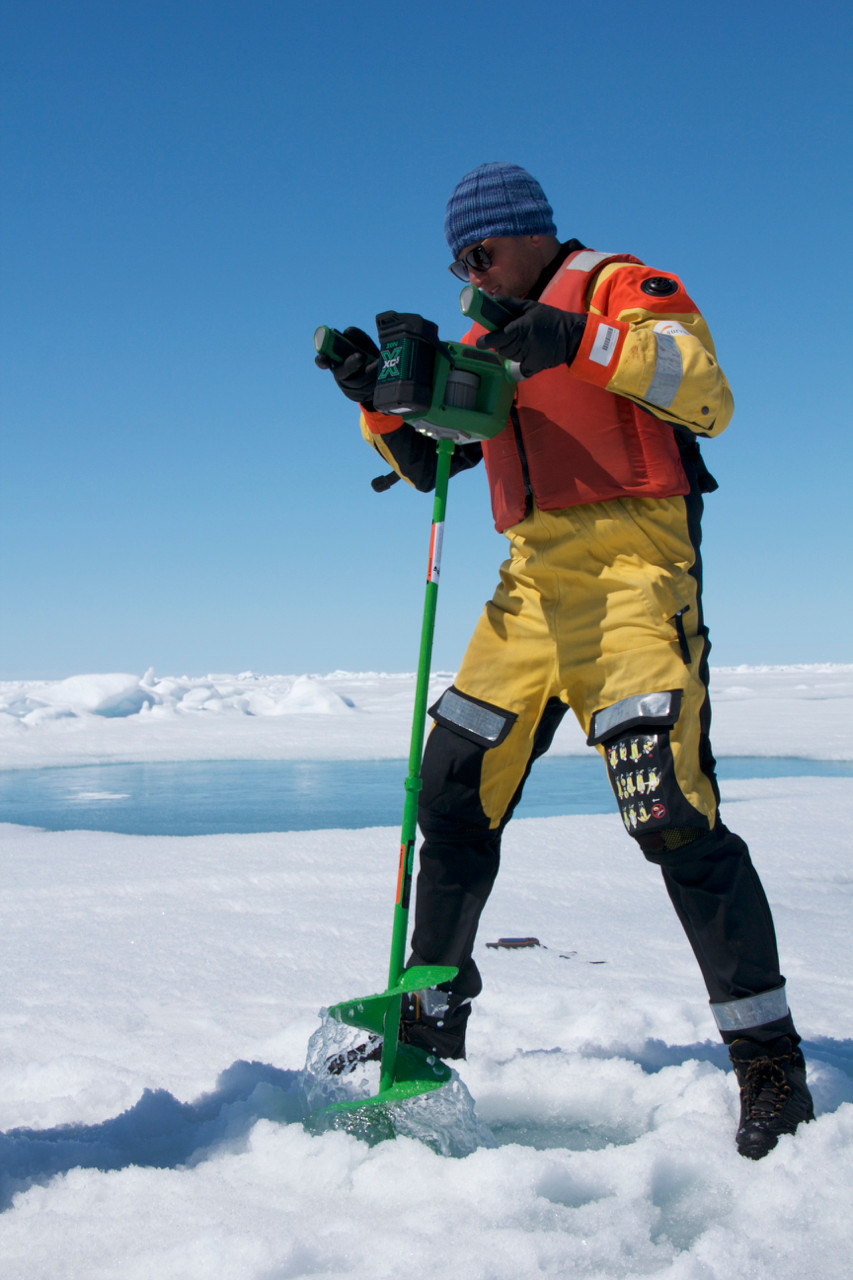 Drilling an ice hole to sample water below (Photo credit: Lucette Barber)