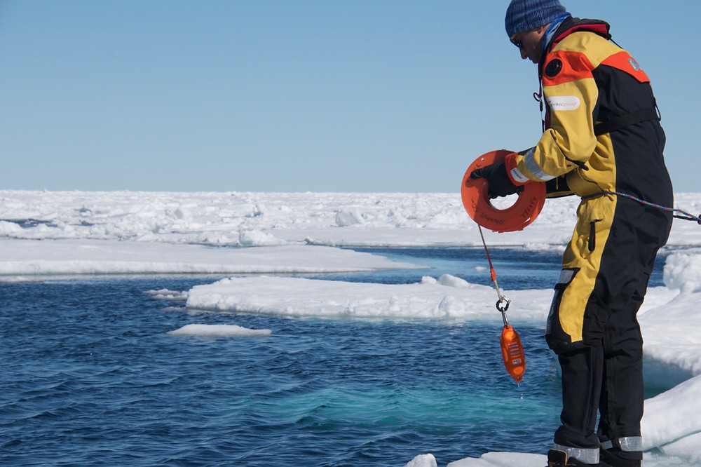 Conducting a CTD (Conductivity-Temperature- Depth) cast from the ice-edge (Photo credit: David Barber)