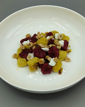 Beet Gnocchi with Goat Cheese and Hazelnuts