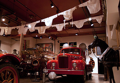 Shirtwaists, similar to those made in the Triangle Factory, hang above apparatus on the museum's first floor.