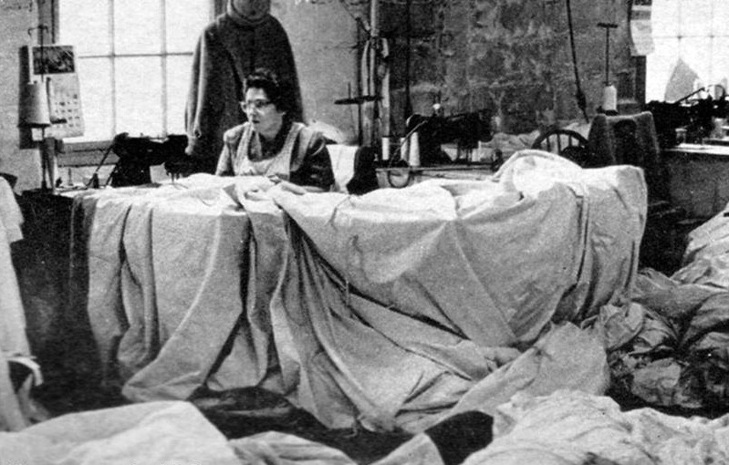 Longtime seamstress, Sarah DeRosa at work on cotton sails.