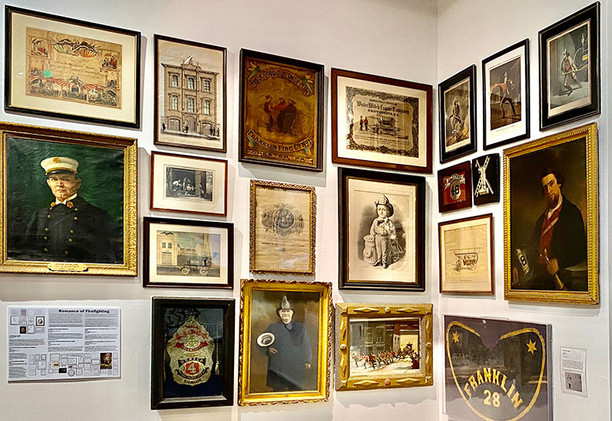 Framed documents and works of art, from portraits of firemen to prints of fire companies racing to fires, illustrate firefighting in the volunteer period.