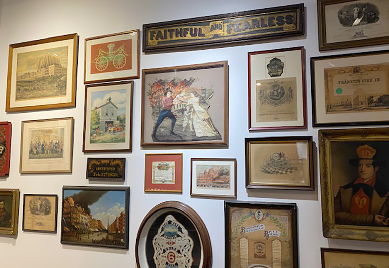 Prints, paintings, and certificates from exempt and veteran associations highlight the fraternal and social aspects of the volunteer period, which continued into the paid department.