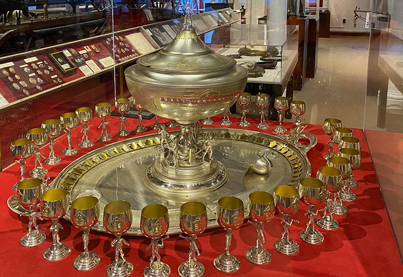 This silver service set was presented to the President of the Firemen's Charitable Association of New Orleans on the occasion of his retirement in 1872. It is elaborately engraved and decorated with symbols of the volunteer department.