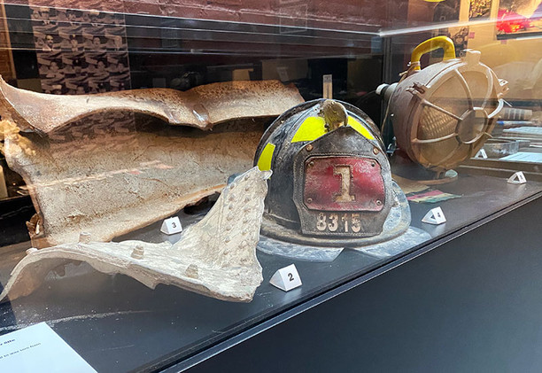 Exhibit case of recovered items featured in the September 11th memorial room.