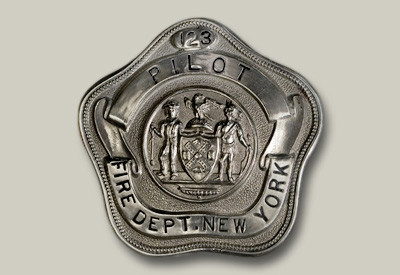 This is a pentagon-shaped breast badge, also worn by fireboat Pilots. The pentagon style was used until the early 1950s.