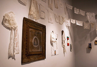 Other smaller, similarly intimate pieces relating to the Triangle Fire hang on the walls below the embroidered shirtwaists.