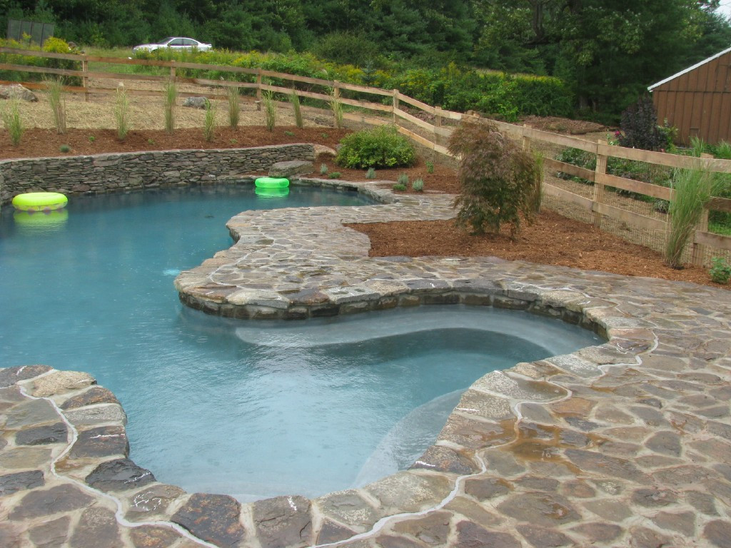 Natural stone pool and retaining wall