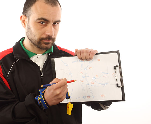 soccer manager drawing a tactical plan.j