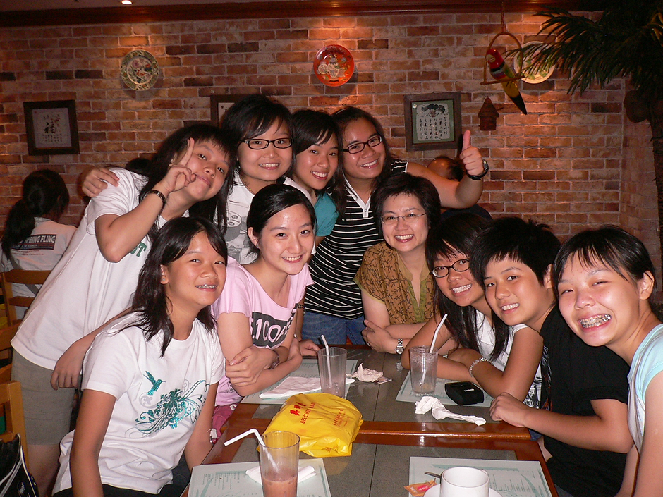 Celebrating with a group of students after a 10-day voluntary service in Mainland China, 2006