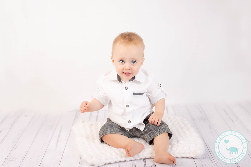 Sitting one year old at Cake Smash Photography session