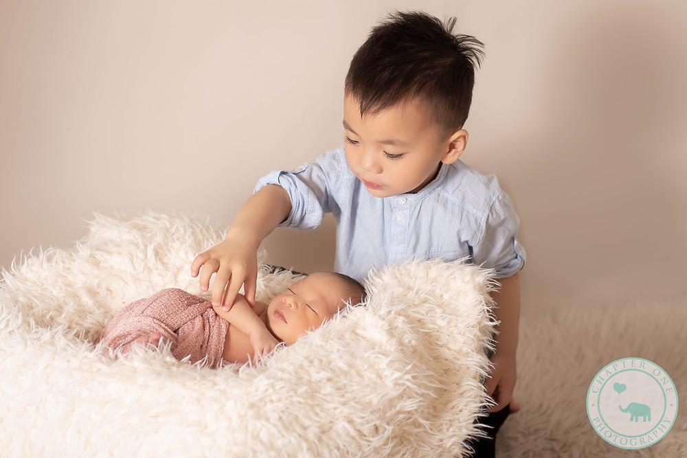 Newborn girl with big brother 2 years
