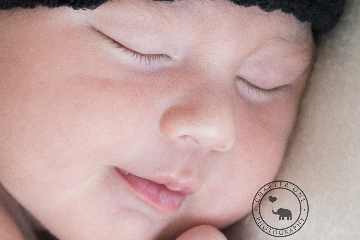 macro shot of newborn baby's face