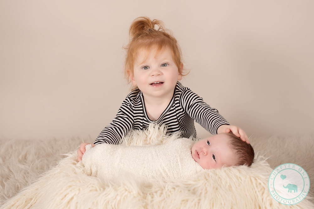 Big sister with newborn girl