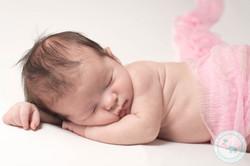 baby girl in pink newborn photograph