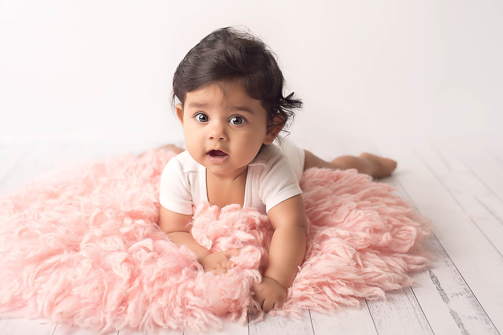 baby photography - girl on pink fur
