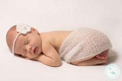 newborn girl wearing headband