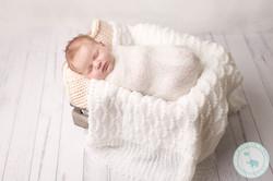 Baby Girl Newborn in white crate
