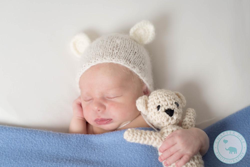 newborn boy and teddy bear
