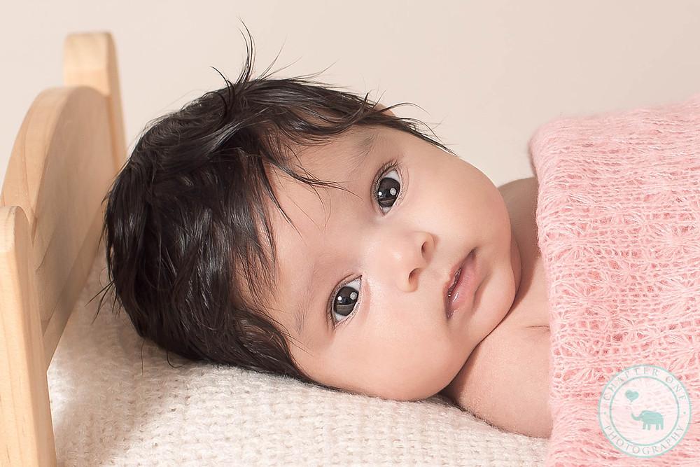 Newborn Baby Girl in baby bed