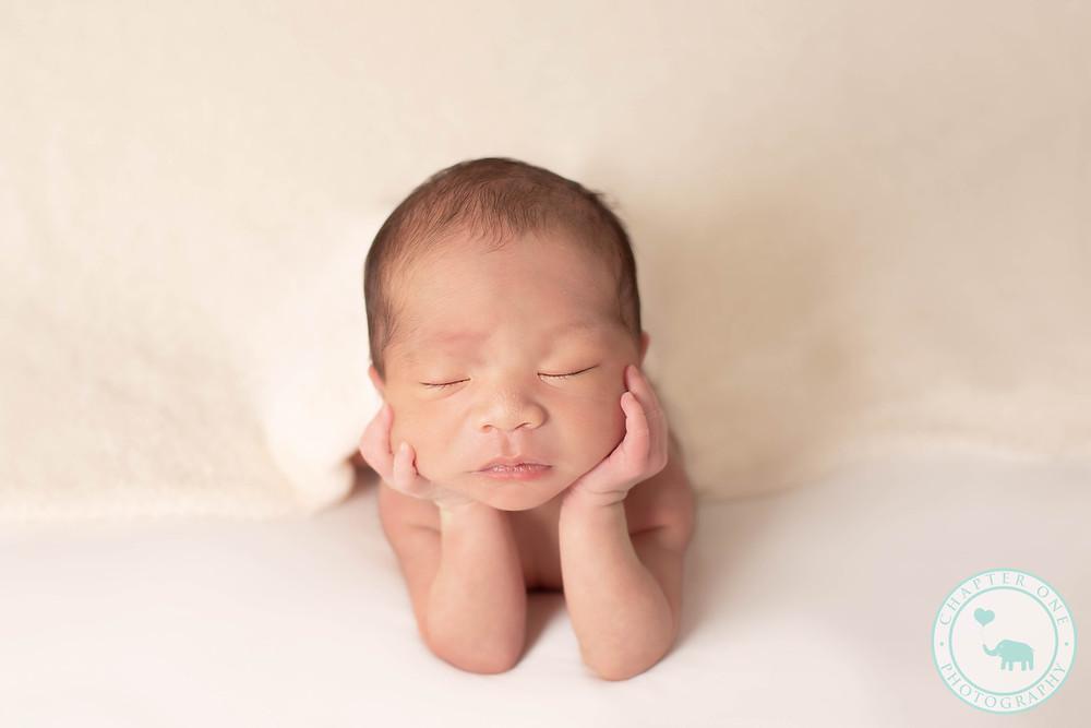 newborn girl in froggy pose