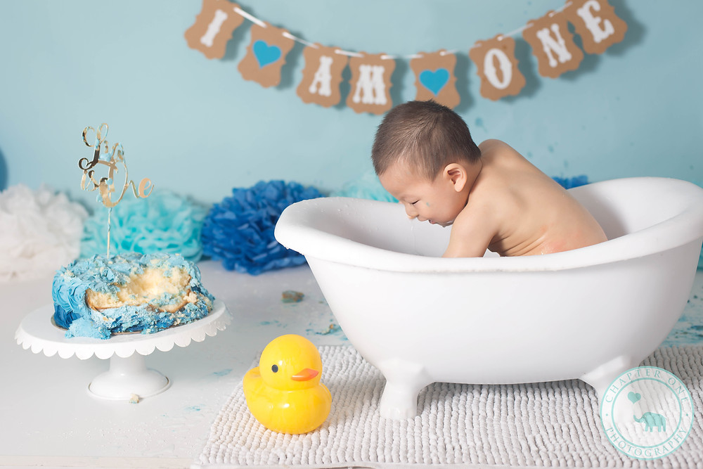 Baby in bath after cake session