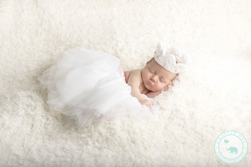 Newborn girl in tutu and crown