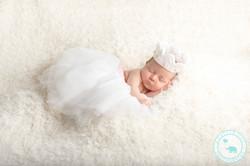 Newborn girl in tutu and crown