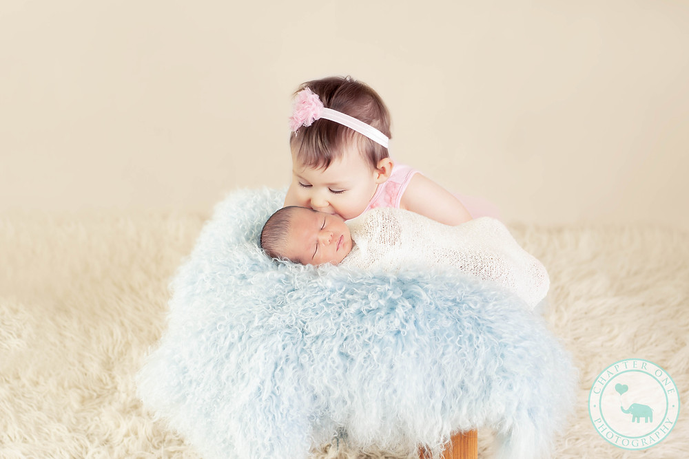Newborn Photography - baby boy gets kisses from big sister