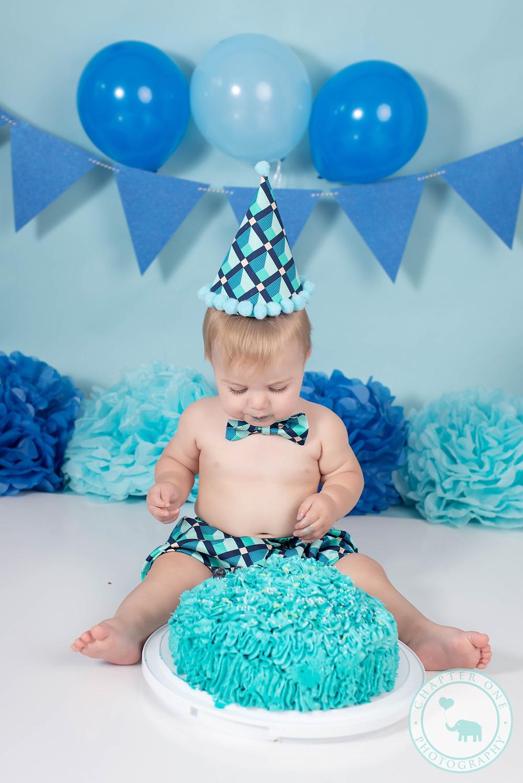 baby boy enjoying his cake smash