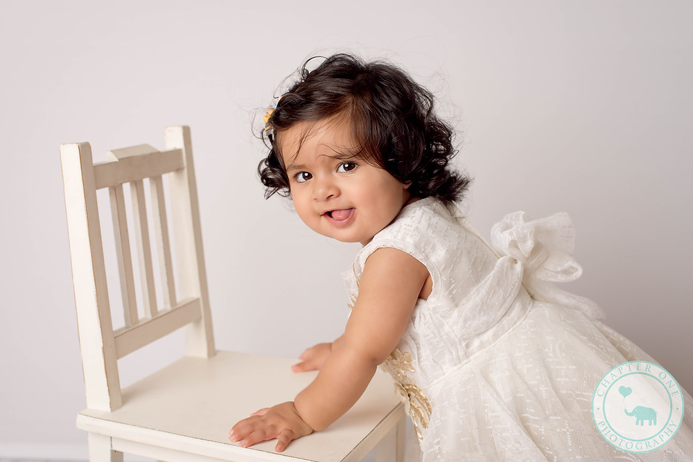 Baby girl with chair