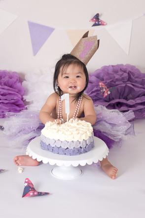 Girl cake smash purple.jpg