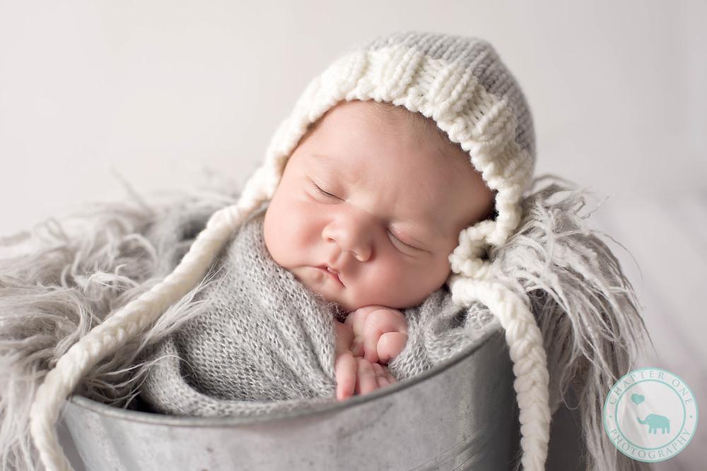 Newborn boy in grey hat