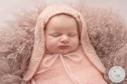 Newborn girl with rabbit hat