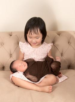Newborn baby boy with older sister