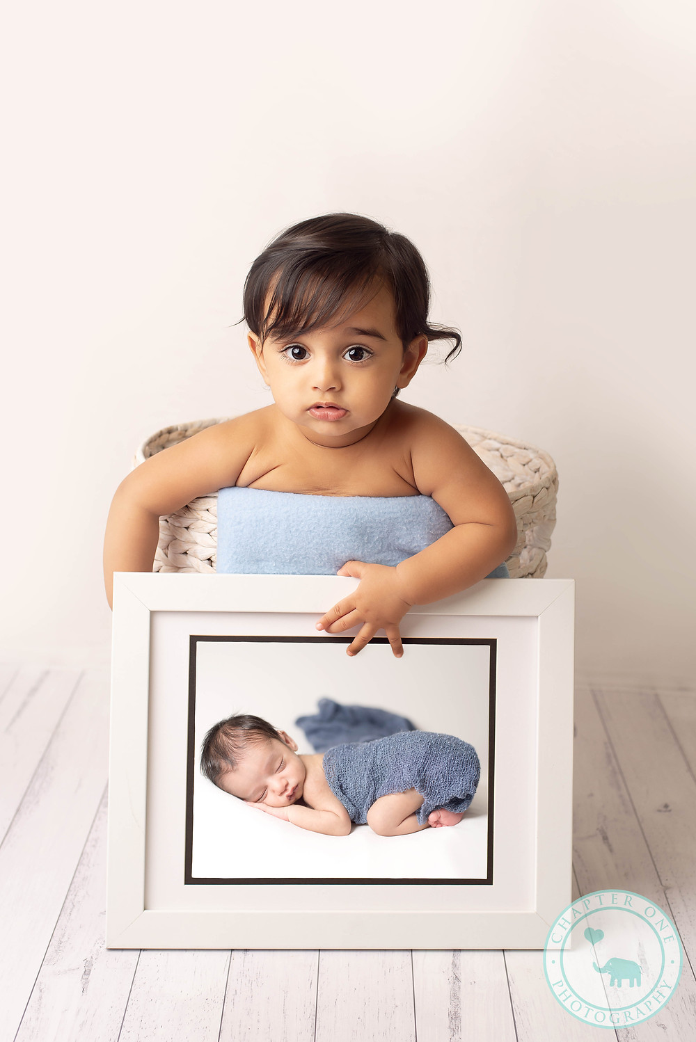 6 month boy with his newborn photograph