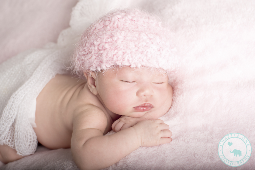 Newborn girl in pink beanie