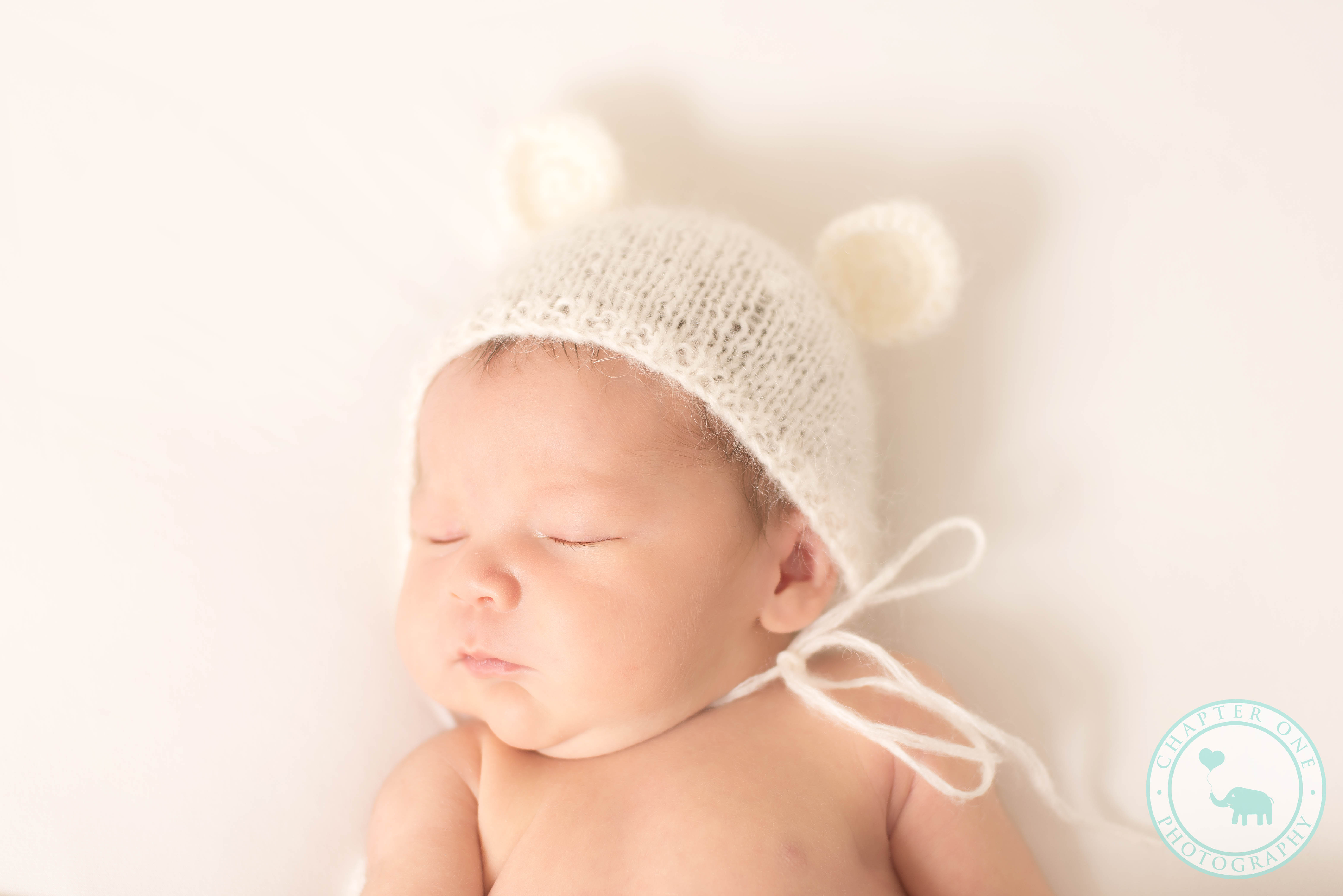 Newborn baby boy in a teddy hat