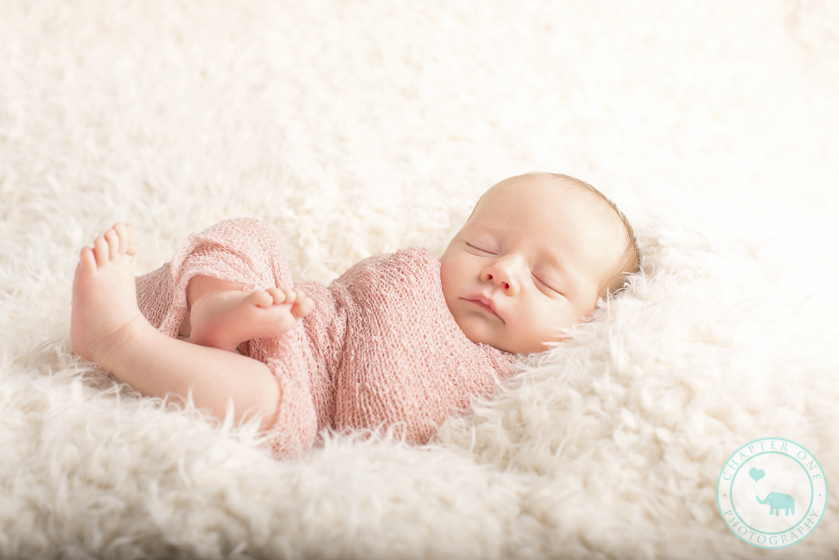 Newborn girl wrapped in pink