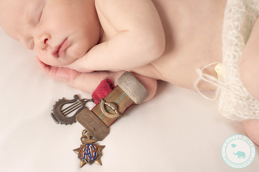 Newborn boy with Grand father's medals
