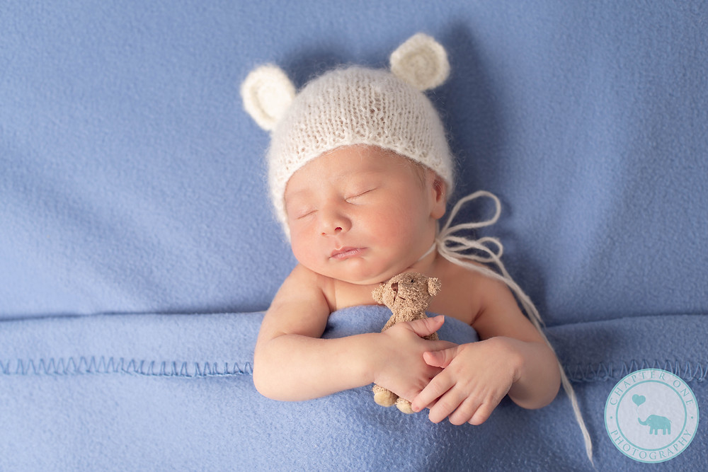 Newborn boy with teddy