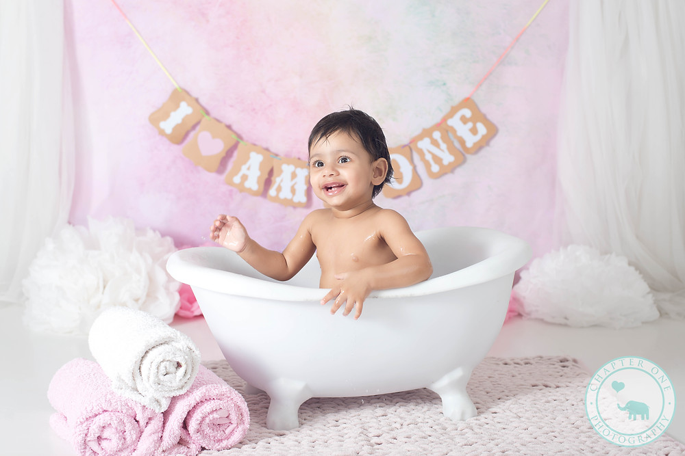 One year old in a bath post Cake Smash