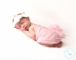 Newborn girl with bow headband