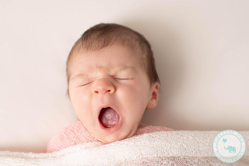 Newborn girl yawing