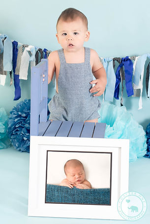 One year old with his newborn photograph.jpg