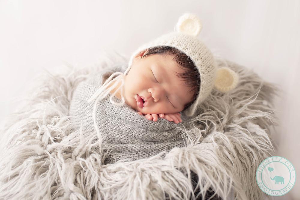 Newborn boy with bear hat