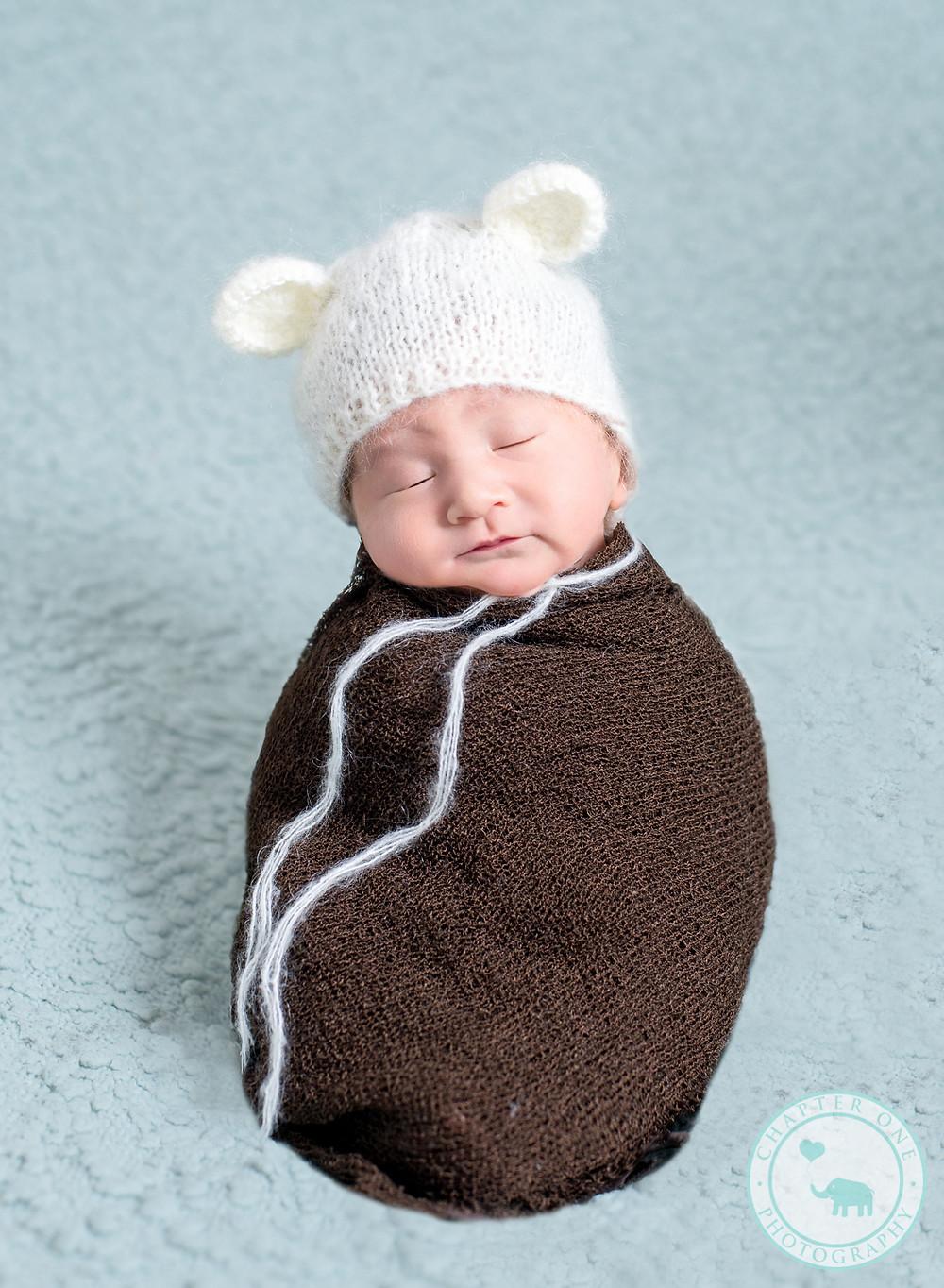 newborn cocoon pose
