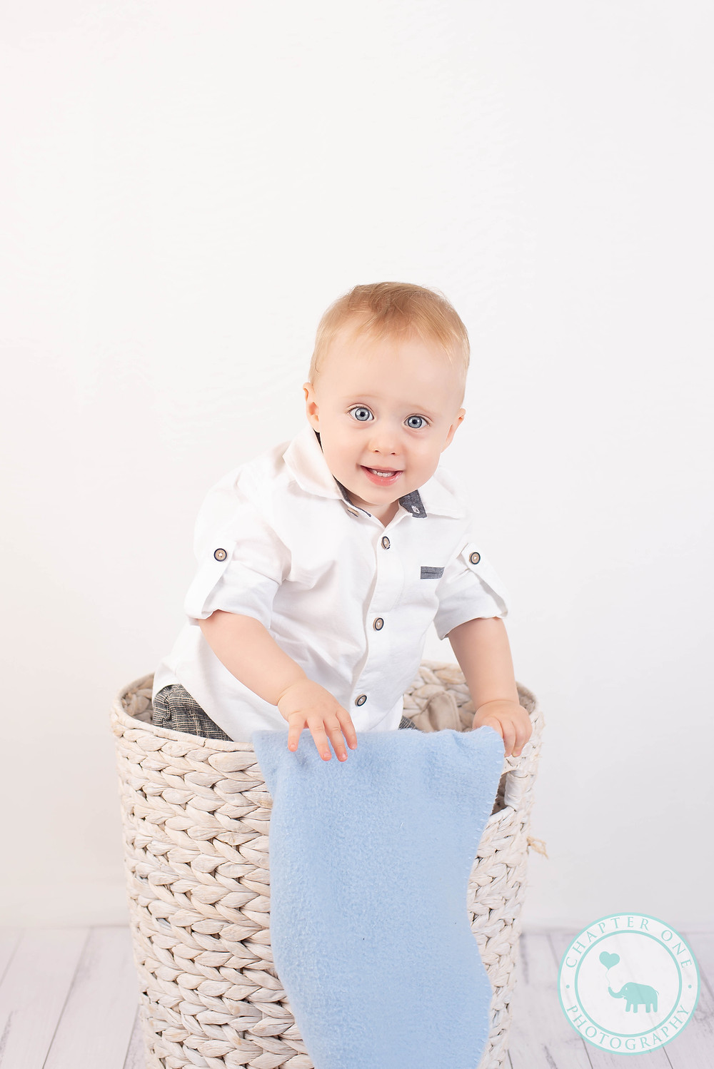 Baby boy in white photography session